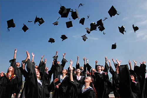 Students celebrating graduation